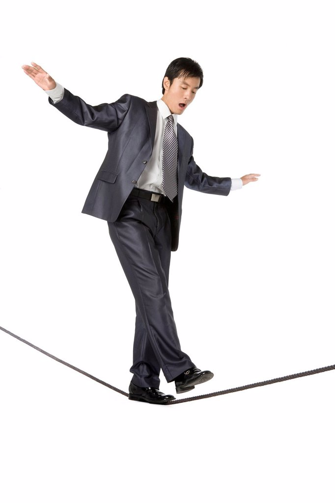 Stock Photo: 1839R-13886 Businessman walking on rope in mid_air