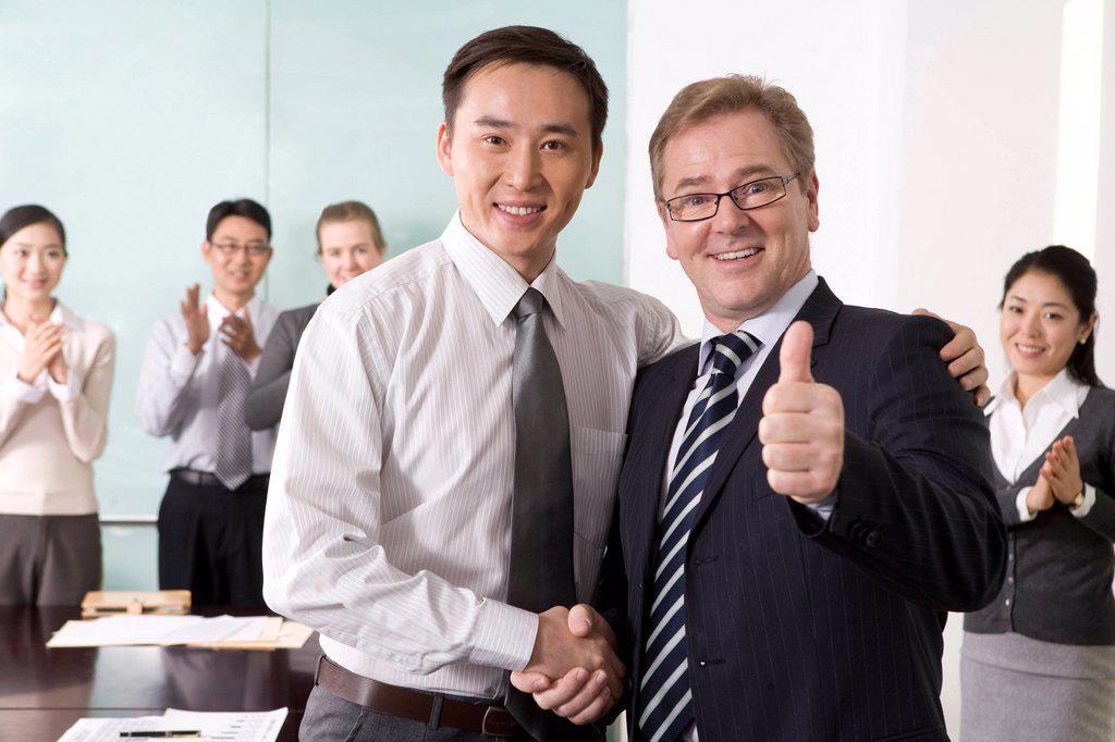 Stock Photo: 1839R-14939 Businesspeople cheering