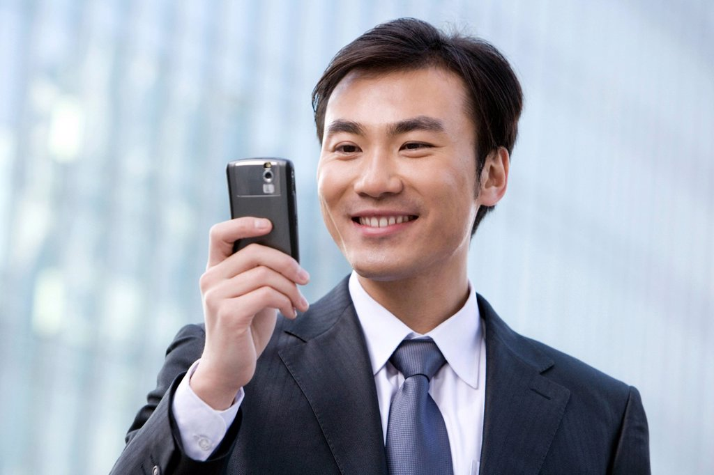 Stock Photo: 1839R-15011 Businessman using cellphone