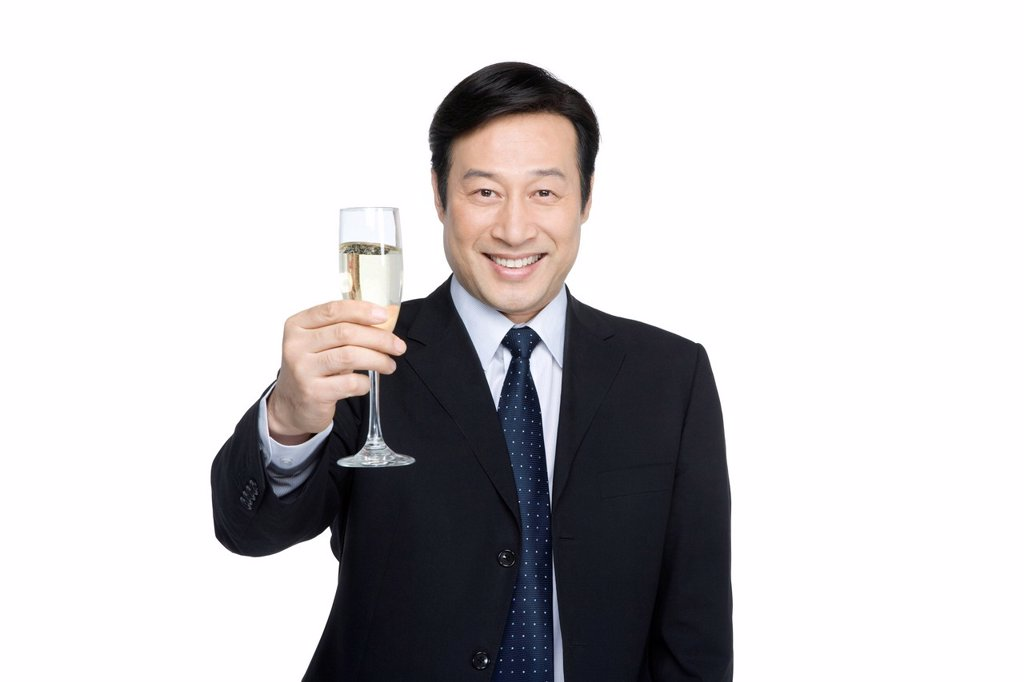 Stock Photo: 1839R-15120 Businessman toasting with champagne