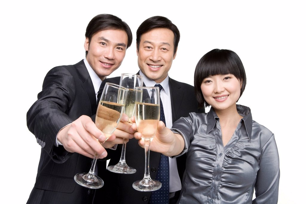 Business team toasting with champagne : Stock Photo