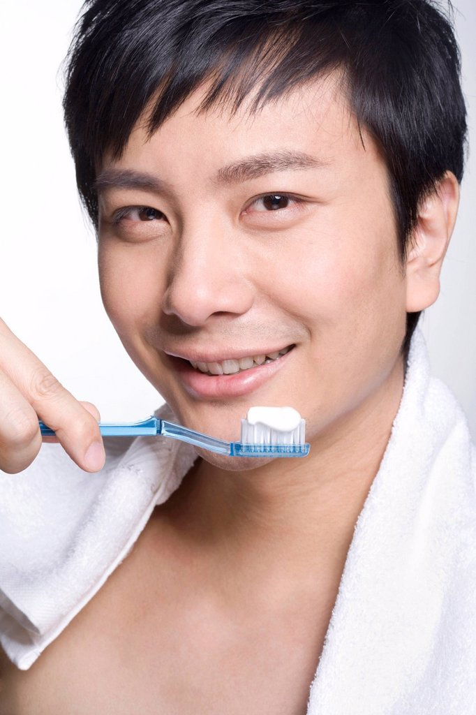 Young man using tooth brush : Stock Photo