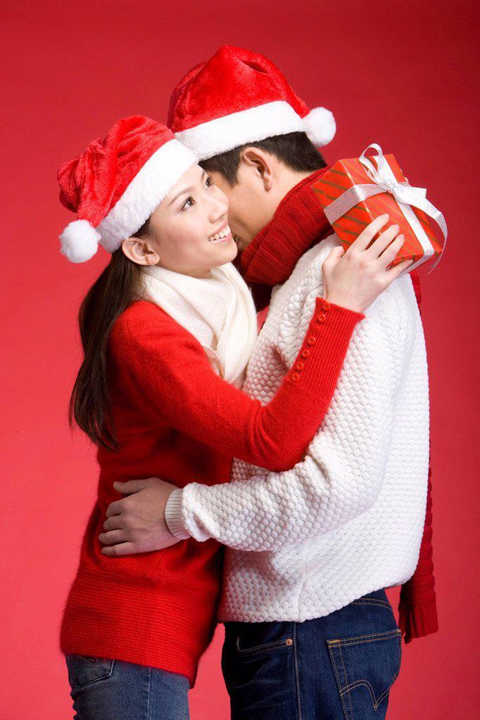 Young couple celebrating Christmas : Stock Photo
