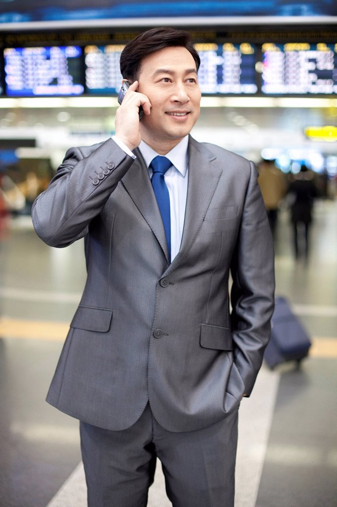 Stock Photo: 1839R-16528 Businessman at the airport