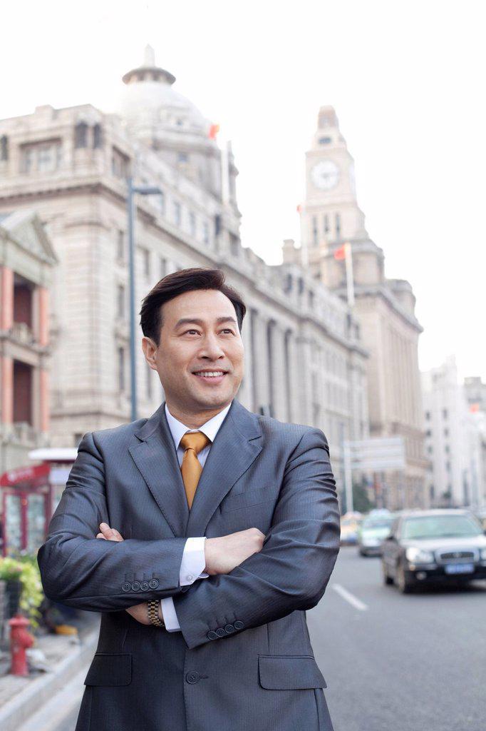 Stock Photo: 1839R-16632 Portrait of businessman on the Bund in Shanghai