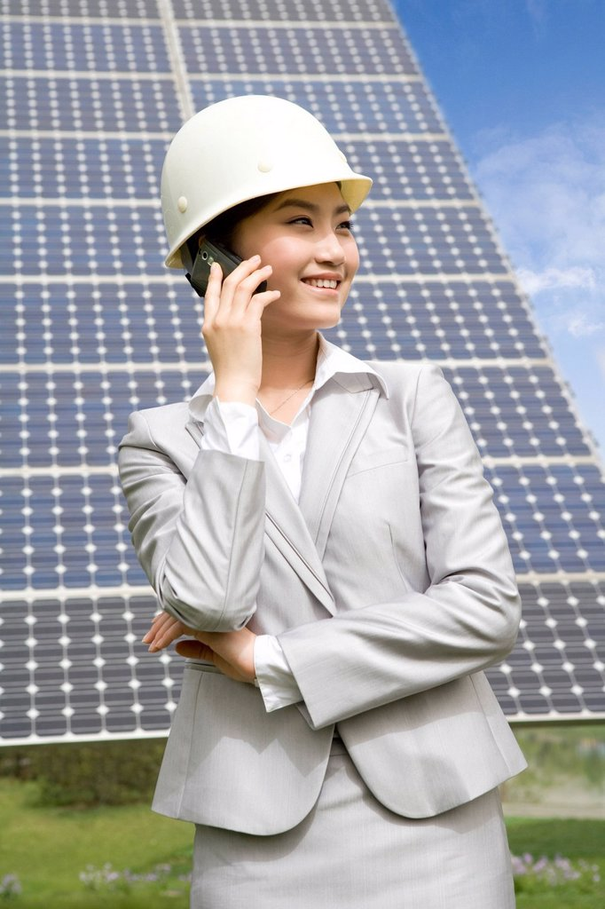 Stock Photo: 1839R-17277 Portrait of an engineer in front of solar panels