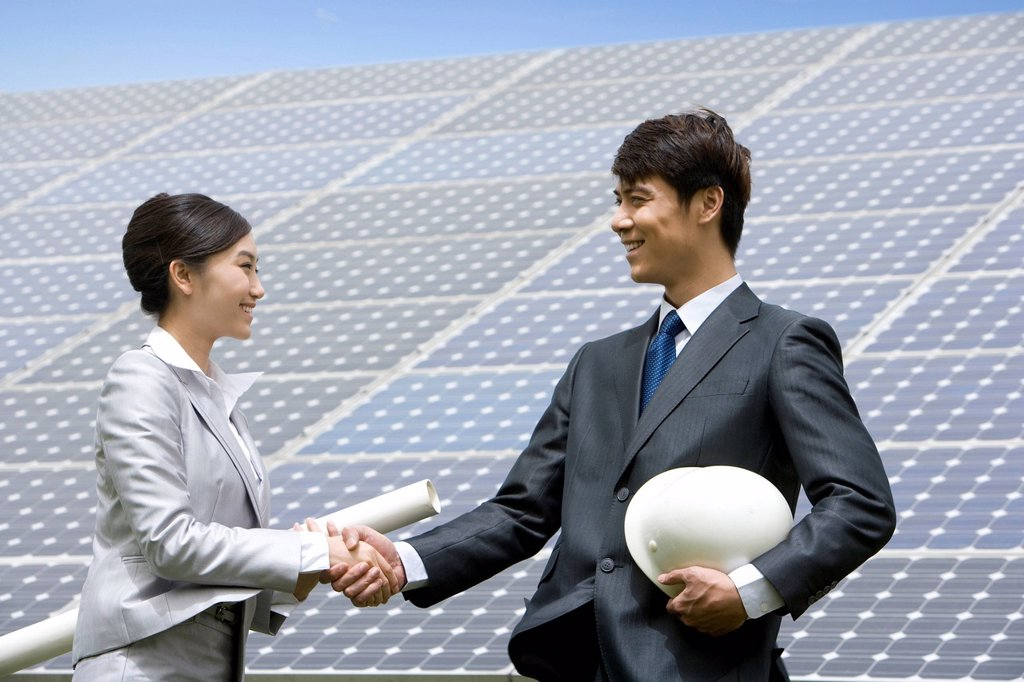 Stock Photo: 1839R-17313 Two engineers in front of solar panels