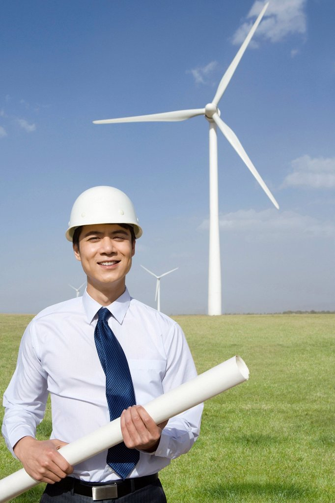 Stock Photo: 1839R-17370 Engineer in front of wind turbines