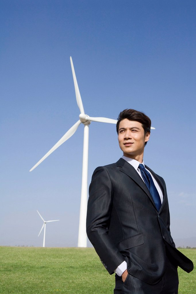 Stock Photo: 1839R-17384 Businessman in front of wind turbine