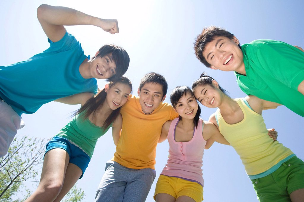 Stock Photo: 1839R-17697 Portrait of a group of friends at the park