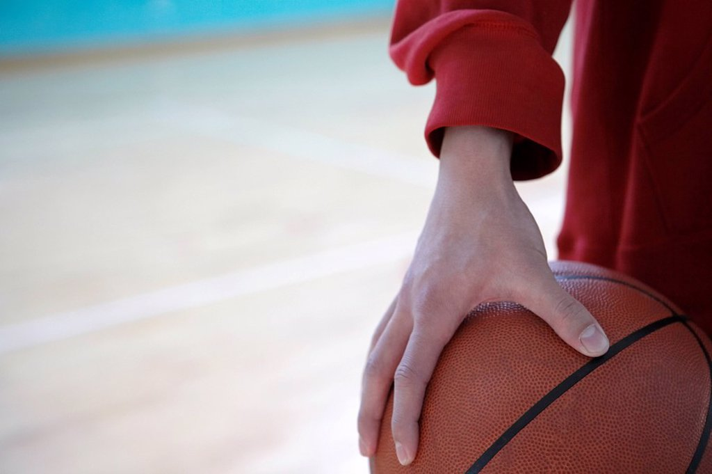 Person Holding A Basketball : Stock Photo