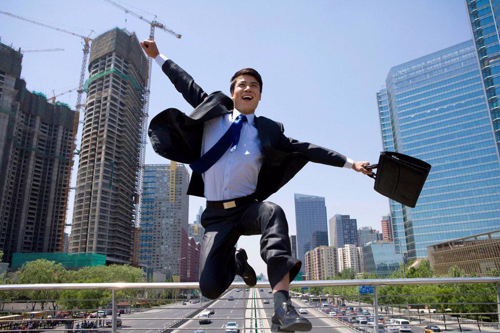 Stock Photo: 1839R-17869 Happy businessman in an urban scene