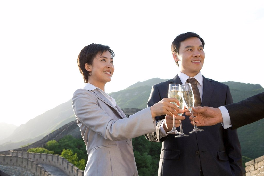 Businesspeople having champagne on the Great Wall : Stock Photo