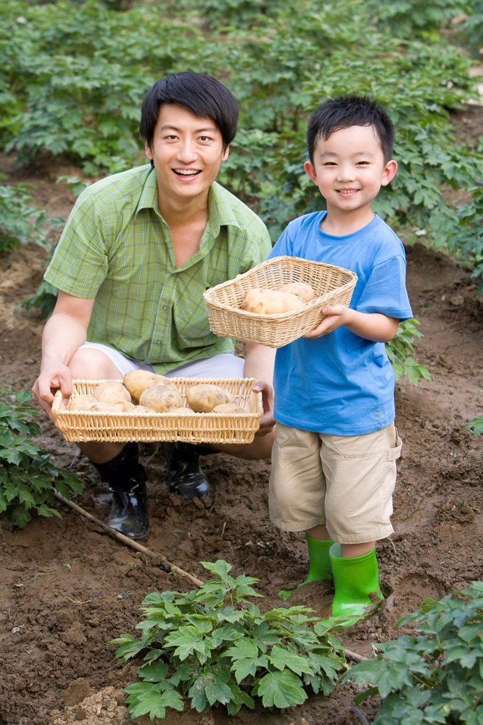 Stock Photo: 1839R-18208 Father and son gardening