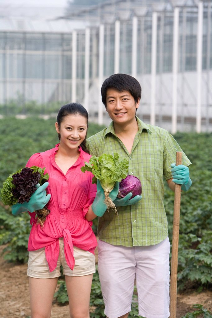 Stock Photo: 1839R-18241 Young couple gardening in farm