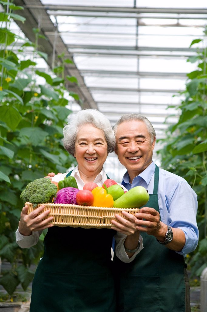 Stock Photo: 1839R-18268 Farmer holding vegetables in modern farm