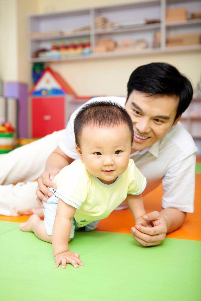 Father Guiding Son : Stock Photo