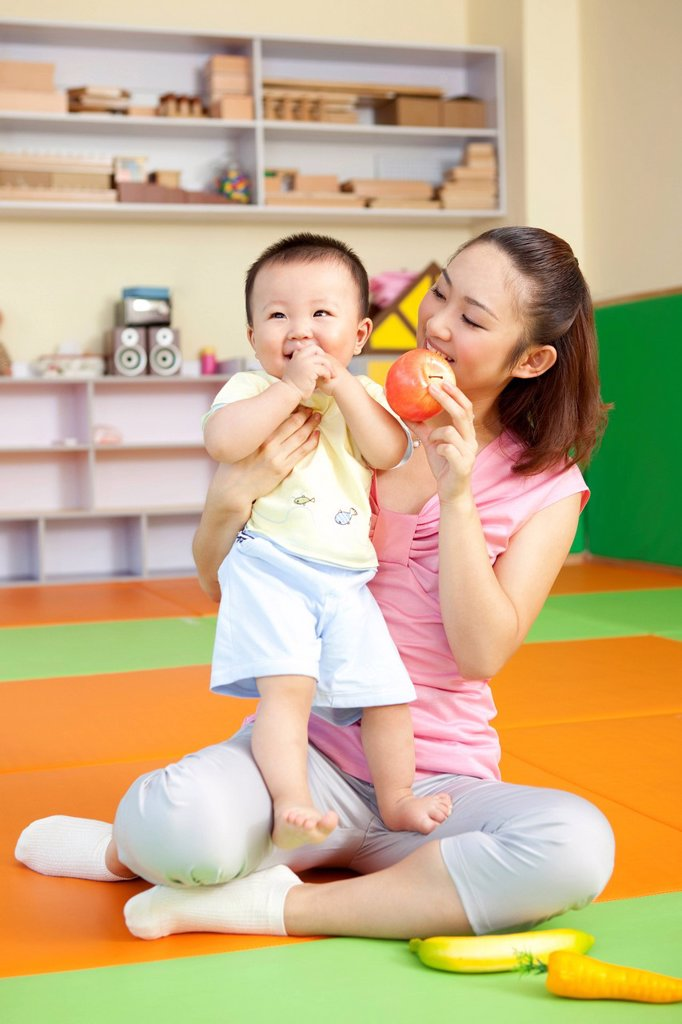 Stock Photo: 1839R-18425 Mother Playing With Son