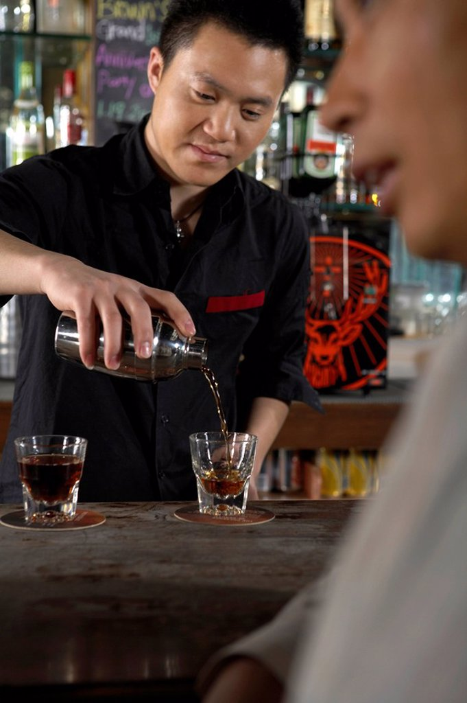 Stock Photo: 1839R-1858 Barman Pouring Drinks