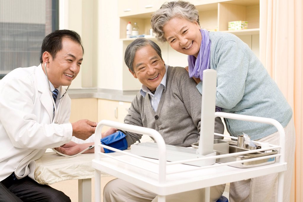 Stock Photo: 1839R-18777 Senior Man Having His Blood Pressure Tested by a Doctor