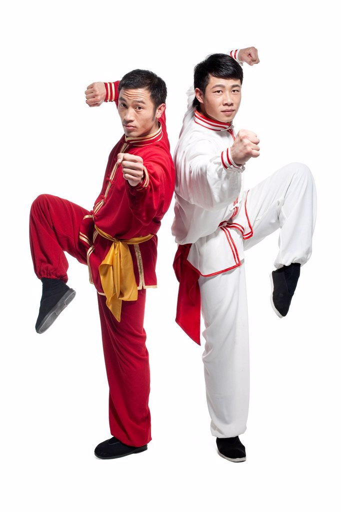 Stock Photo: 1839R-18810 Focused Men Doing Martial Arts in Chinese Clothing
