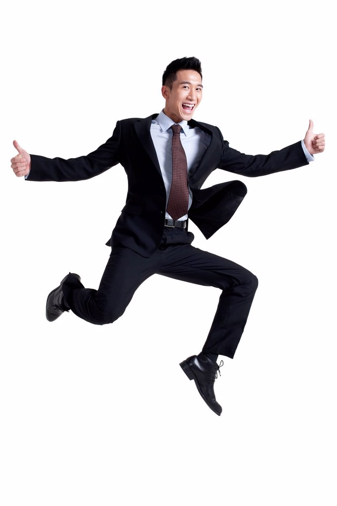 Stock Photo: 1839R-19013 Portrait of an Excited Businessman Jumping Up