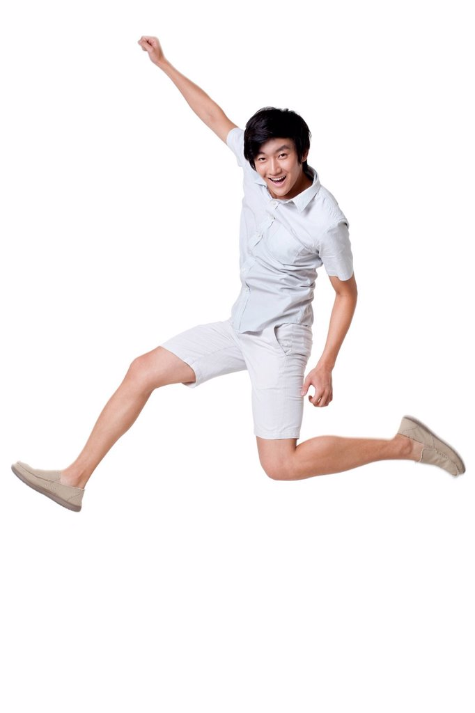 Stock Photo: 1839R-19033 Young Man Jumping In the Air