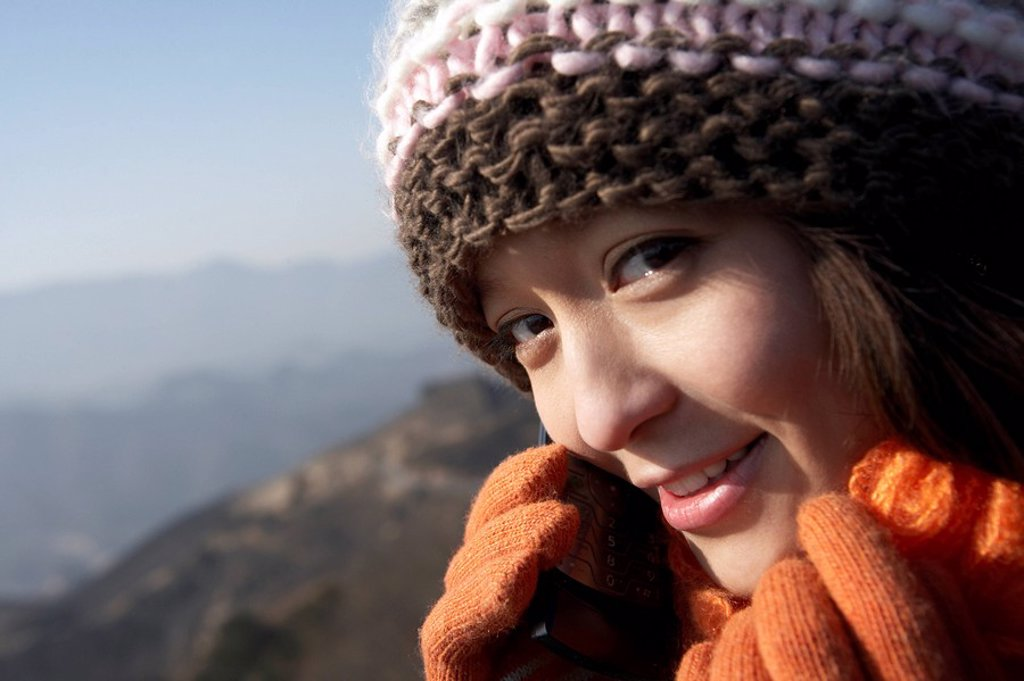 Young Woman On The Great Wall Of China, Talking On Her Cellphone : Stock Photo
