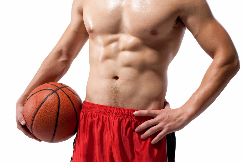 Stock Photo: 1839R-19223 Torso of a shirtless muscular man holding a basketball