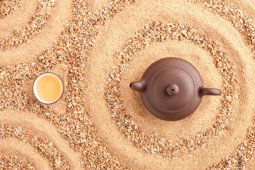 Tea set in sand : Stock Photo