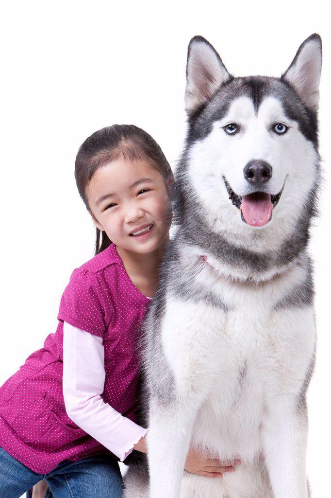 Stock Photo: 1839R-19305 Cute girl with husky