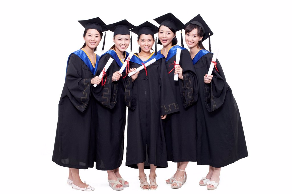 Portrait of alumnae holding diploma : Stock Photo