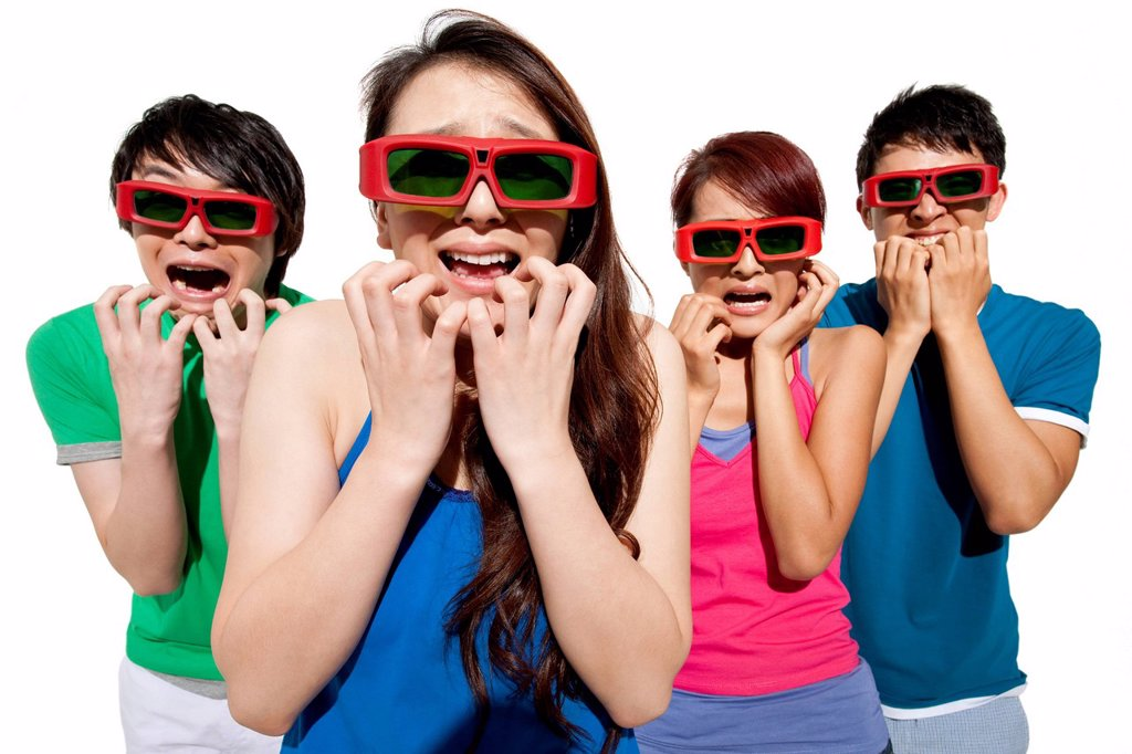 Stock Photo: 1839R-19778 Young people waching 3D movie
