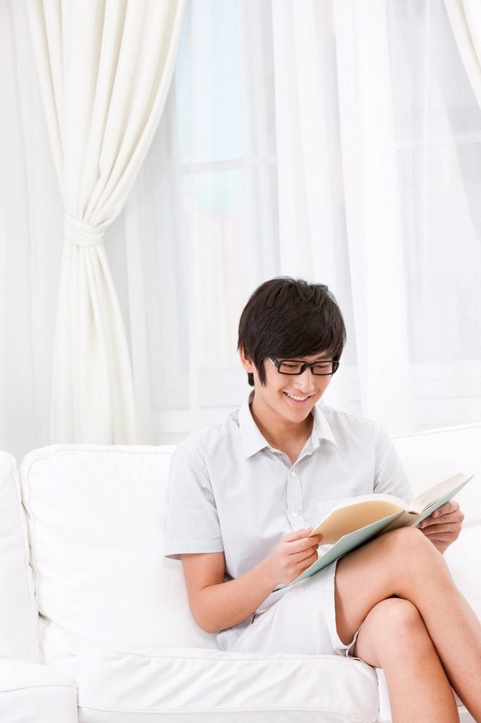 Young Man Reading at Home : Stock Photo