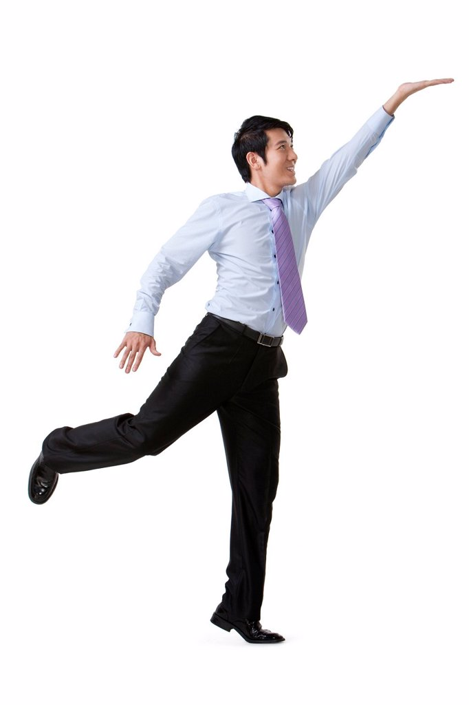 Stock Photo: 1839R-19859 Businessman Reaching Up and Holding an Object