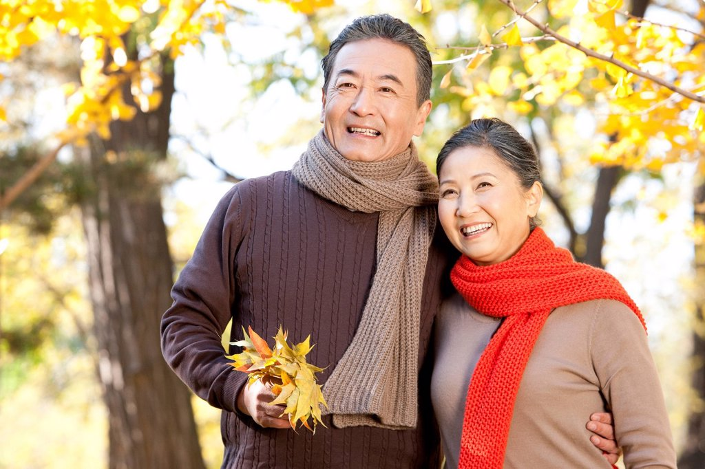 Stock Photo: 1839R-19954 Senior couple walking in a park in Autumn