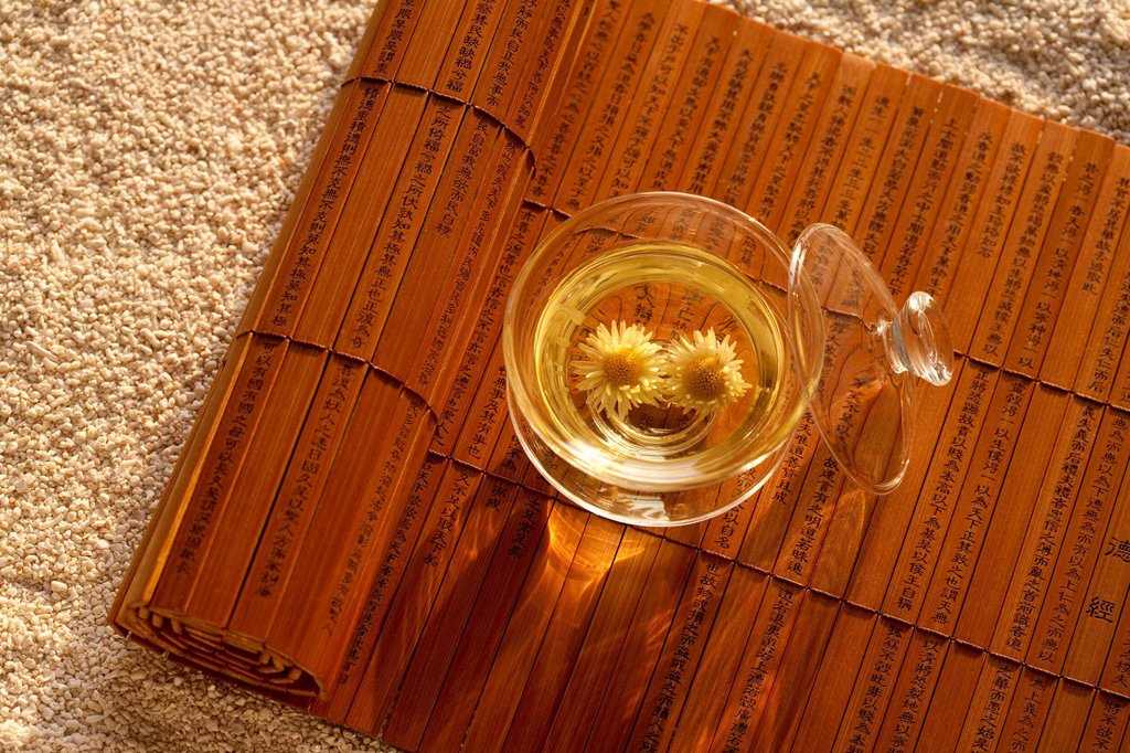 Close_up of Chrysanthemum Tea and bamboo slip : Stock Photo