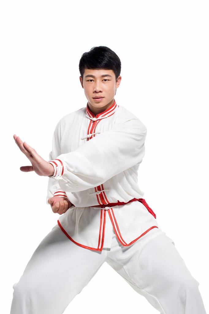Man in Traditional Chinese Clothing Doing Taijiquan : Stock Photo