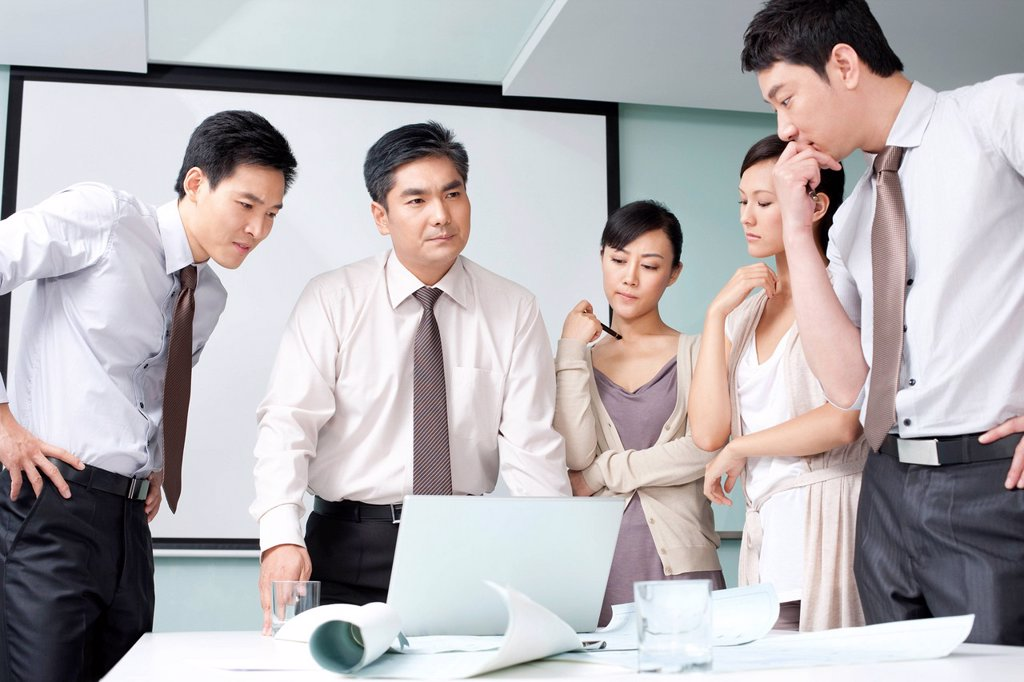 Stock Photo: 1839R-20469 Business Team Examining Business Plan