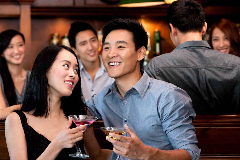 Stock Photo: 1839R-20513 Couple Enjoying Cocktails Together