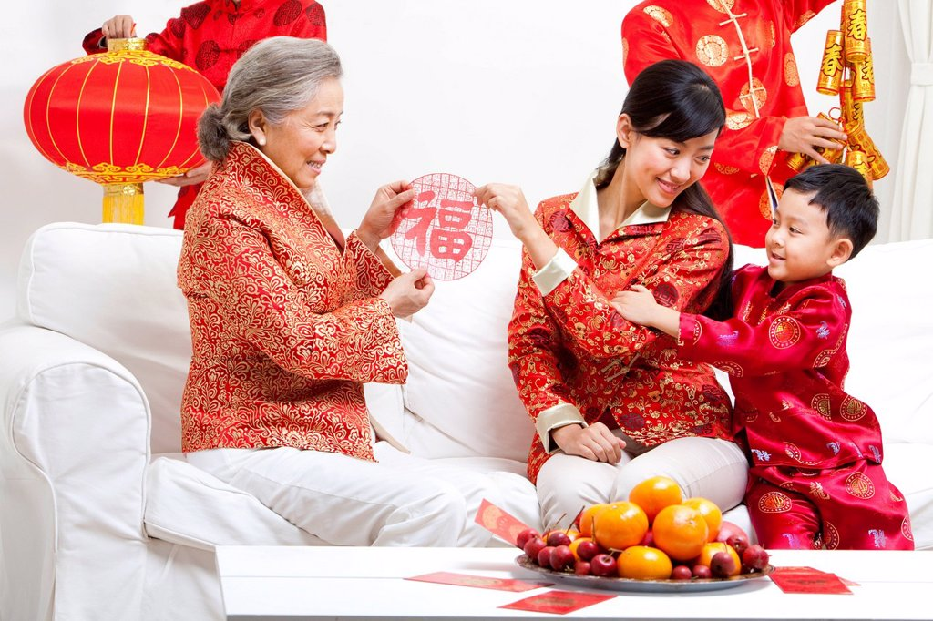 Stock Photo: 1839R-20602 Family Celebrating Chinese New Year