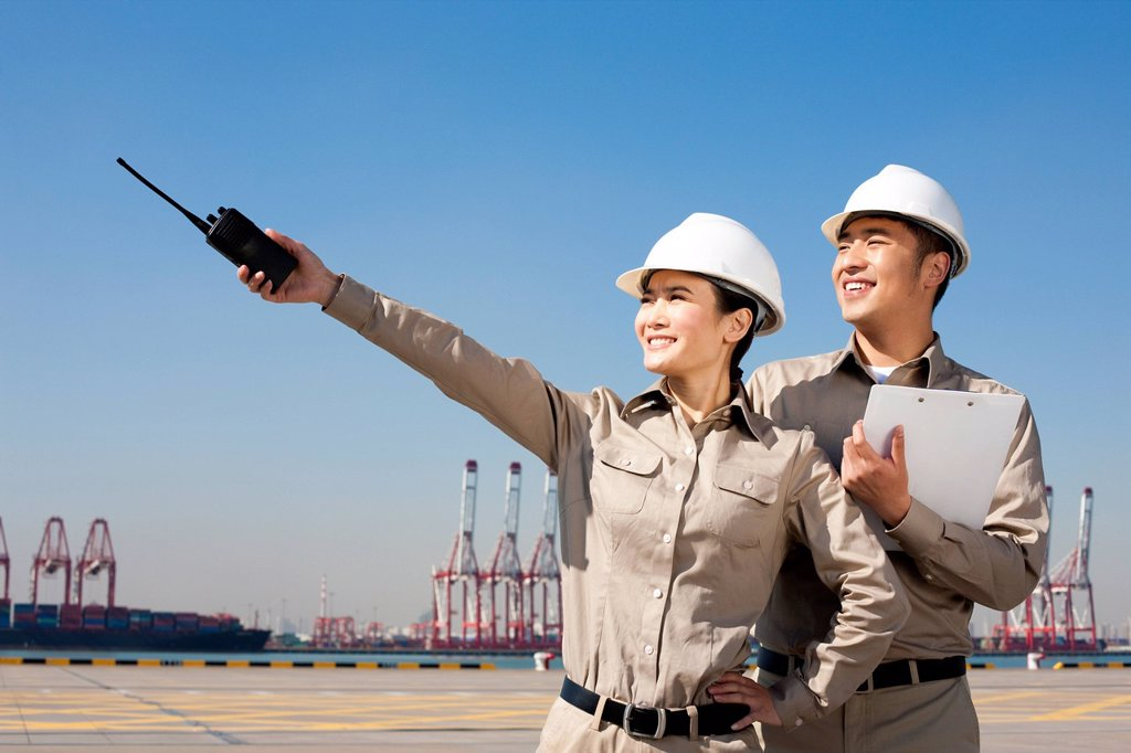 Stock Photo: 1839R-20638 shipping industry workers pointing with walkie_talkie