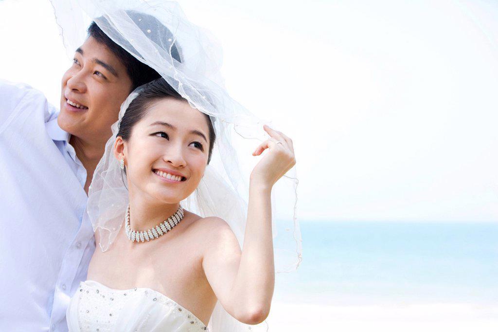 Stock Photo: 1839R-21127 Portrait of Happy Newlyweds