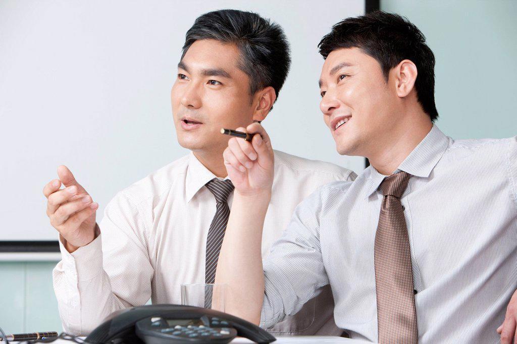 Businessmen Deliberating : Stock Photo