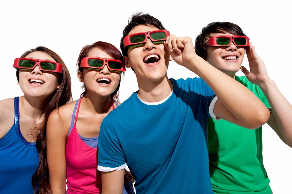 Stock Photo: 1839R-21264 Young people waching 3D movie