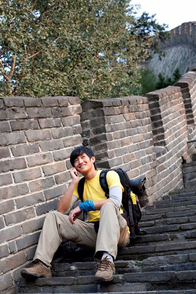 Stock Photo: 1839R-21362 Young people using cellphone on the Great Wall