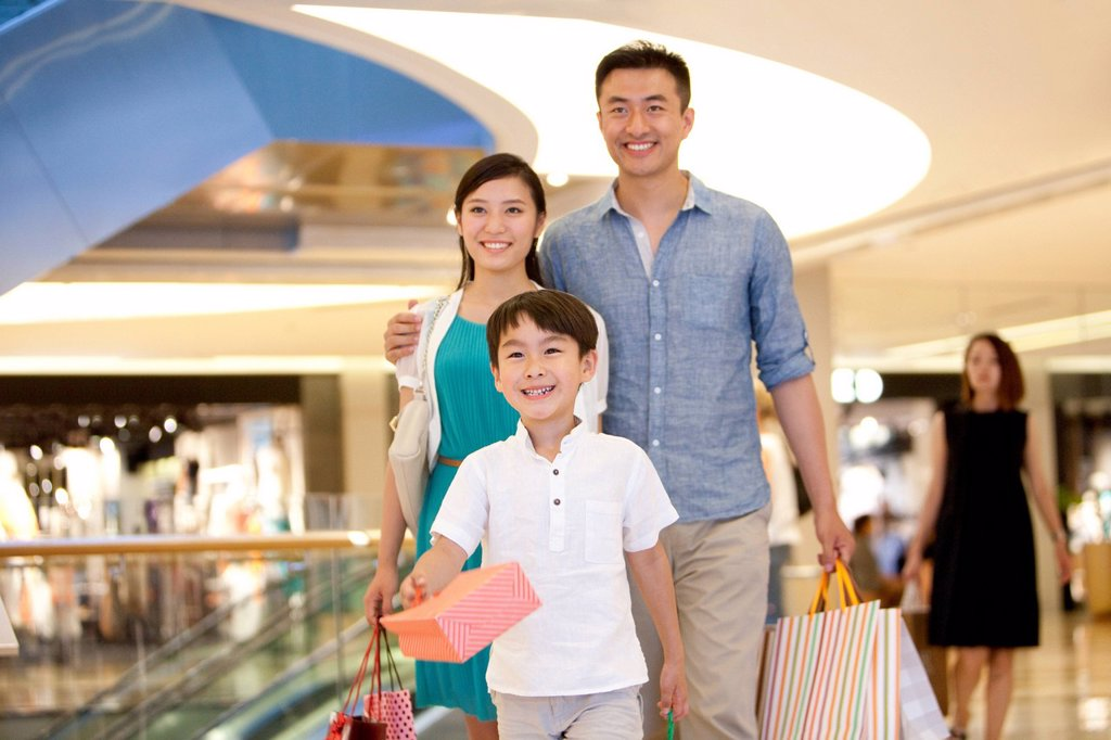 Stock Photo: 1839R-21678 Family shopping in department store