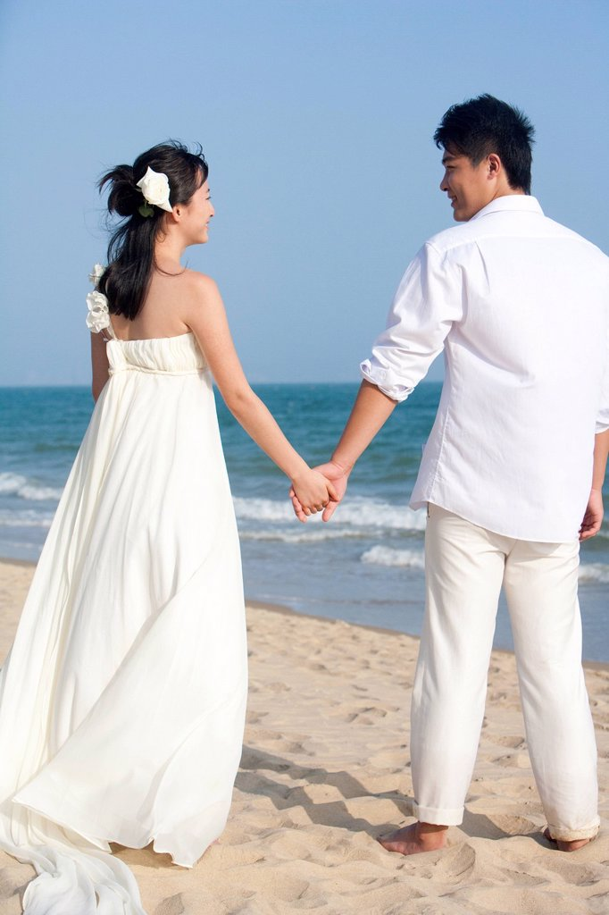 Stock Photo: 1839R-21964 Happy Newlyweds on the Beach