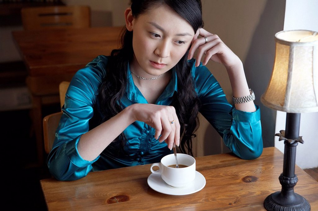 Woman Drinking Coffee Looking Contemplative : Stock Photo