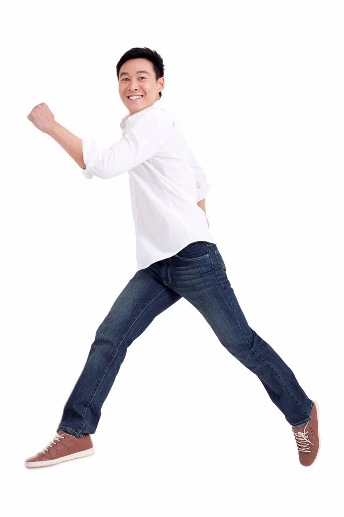 Young man jumping in mid air : Stock Photo